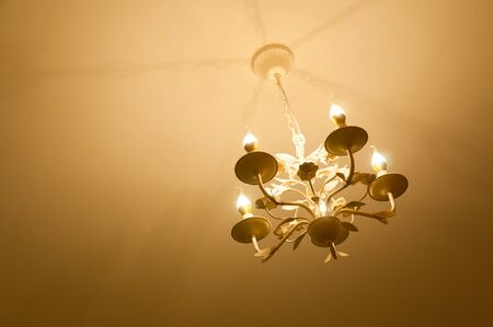electric fixture: Simple chandelier bottom view with ceiling background,modern chandelier