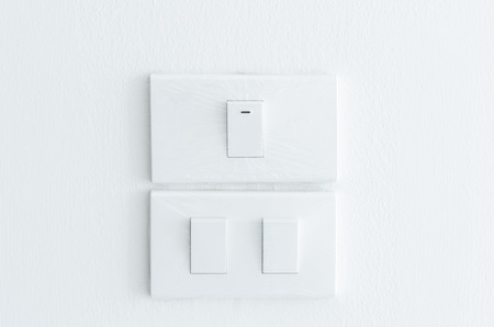 light Switch Cover with plastic on wall