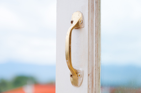 fiberglass handle: Golden Stainless steel vintage style handle on painted wooden white window, Furniture handles