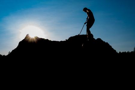 rappeling: Climber on sunset sky background