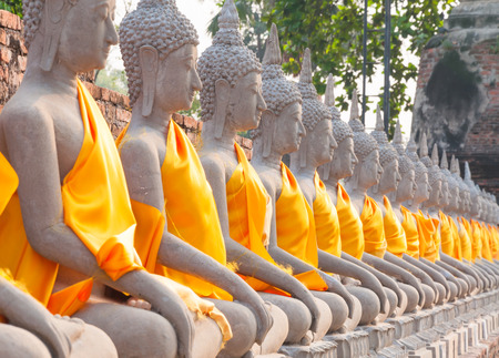 Buddha statues in at Wat Yai Chaimongkol in Ayutthaya Thailand, in Ayutthaya historical park, which is recognized as a unesco world heritage site Stock Photo