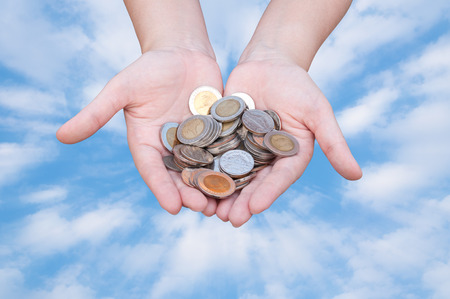 gratuity: Coins in hands on blue sky,Donation Investment Fund Financial Support Charity  Dividend Market Growth Home House Stock Trust Wealthy Giving Planned Accounting Collection Debt Banking ROI concept