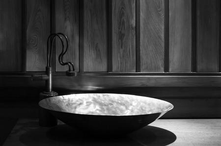 Retro style bathroom ,detail view of copper sink ,of retro design,Vintage bathroom decoration with faucet ,Monochrome