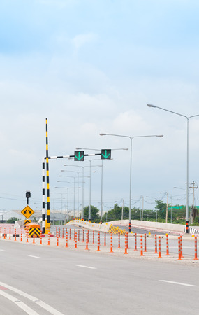 Traffic Light Signal, Road Markings and Pass Either Side , Dangerous Obstruction Warning Sign countryside Highway in Thailand