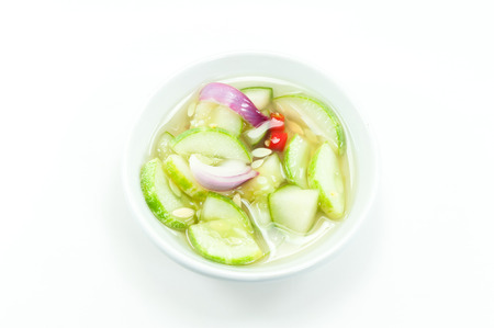 Vinegar with cucumber shallots on white background