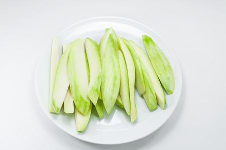 Mango split on white dish on white background Stock Photo