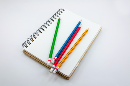 Notebook and Colorful Pencil  on white background