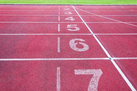 Numbers starting point on red running track,running track and green grass,Direct athletics Running track at Sport Stadium
