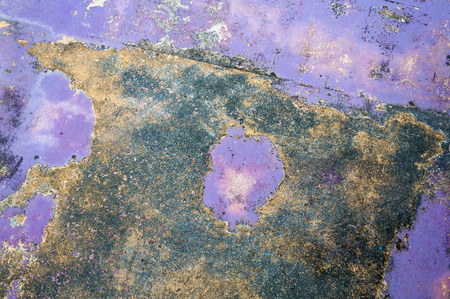 old peeling paint on old purple concrete wall background,Grunge purple floor background or texture