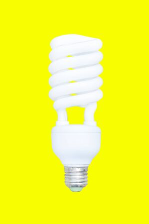 florescent light: Energy saving bulb,Fluorescent spiral light bulb isolated on yellow background Stock Photo