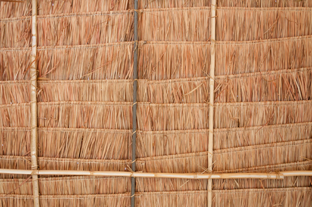 a house with a straw: Rural house roof made of cogon grass,thatch roof background,Basketwork,Straw pattern roof background and texture