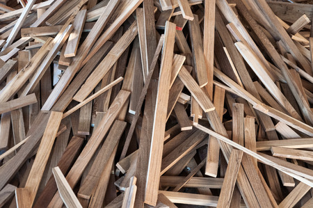 Pile of wood logs for build Furniture production,sew natural wood scraps, ready to recycle and reuse process in improved waste management under efficient sustainable approach to save environment
