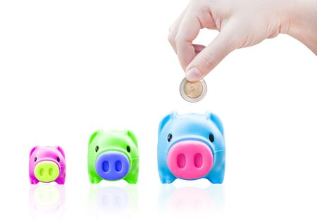 women young hand putting money coin into saving pig, finance theme,Isolated on white background Stock Photo