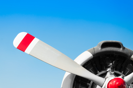 Vintage airplane propeller with radial engine on blue sky Stock Photo