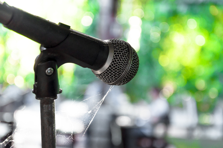old microphone on the stage wasteful abandoned (select focus)