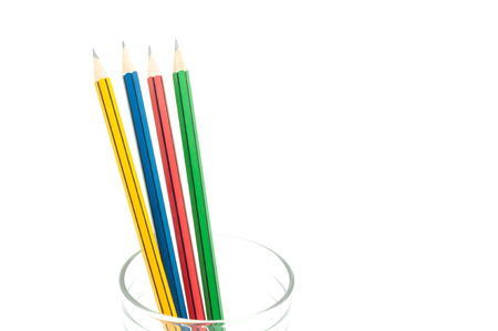 4 Sharp Color Pencils close up in a glass on white background ,for education background