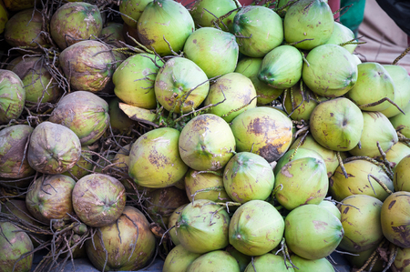 isotonic: Green coconut pile,fresh coconut water isotonic drink