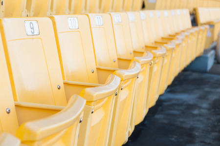 Empty yellow seats at stadium,Rows of seat on a soccer stadium,select focus