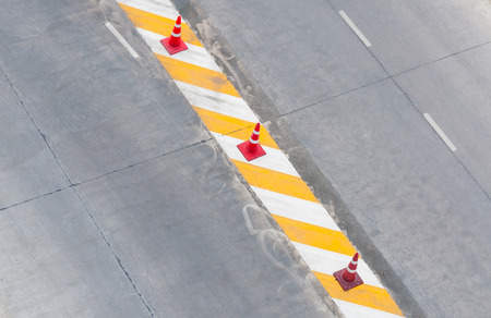 dirty car: road lane with traffic lines concrete White and yellow and  red traffic cone ,on top view Stock Photo