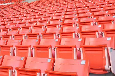Empty orange seats at stadium,Rows of seat on a soccer stadium