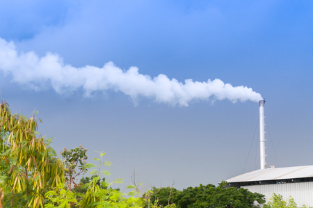 tall chimney: Huge factory chimney polluting the air,Tall chimney emitting  water vapor and smoke Pollution,Industry Causing Pollution Stock Photo
