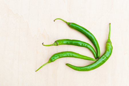 capsaicin: fresh green hot chilli peppers with spicy on the wooden Stock Photo