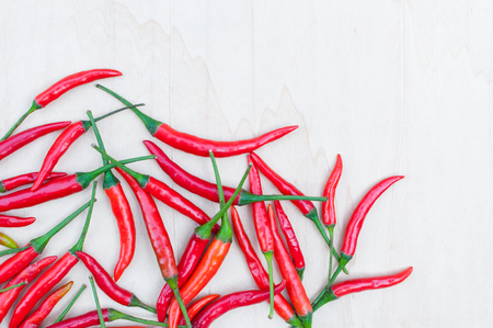 Fresh red hot chilli peppers with spicy on the wooden table with copy space Stock Photo