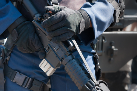 power rangers: Soldier holding a machine with automatic gun.Preparation for military action.Soldier dressed in protective equipment Stock Photo