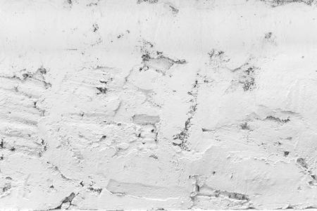 Grijze uitstekende grungeachtergrond of textuurmuur, Textuur van cement of steen oude muur lege ruimte als retro patroonlay-out Stockfoto