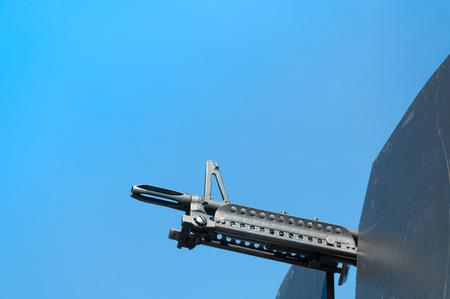 Gun weapons close-up ,machine gun on blue sky,Machine gun on a military vehicle