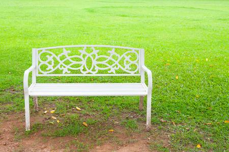 White Chair in the garden green grass background Standard-Bild - 107203473