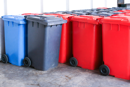 Group of new large colorful wheelie bins for rubbish, recycling waste,Large trash cans (garbage bins) Stock Photo