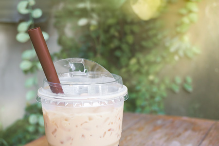 Iced coffee with plastic takeaway glass at the garden Stock Photo