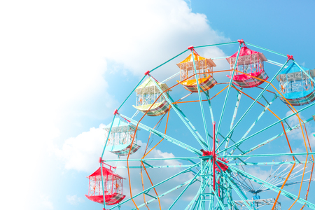 Ferris wheel on the background of blue sky,Colourful Vintage Ferris wheel