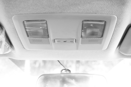 Light at roof in modern car, switch of light, lamp