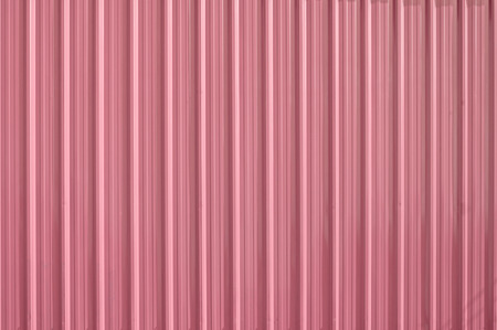 Pink zinc metal corrugated fence,metalsheet fence for background,Abstract background