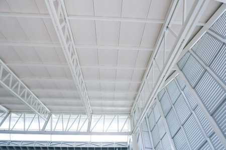 Large steel structure truss, roof frame and metal sheet in building construction site Reklamní fotografie
