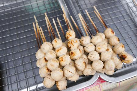 Street food meat ball sticks on grill at Thailand Reklamní fotografie