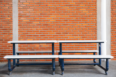 Bench in front of a brick wall blocks at modern building