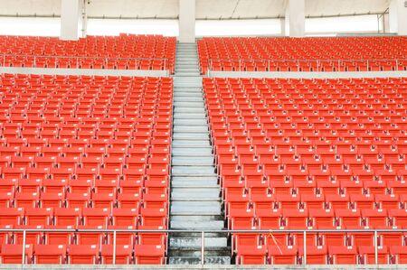 Empty orange seats at stadium,Rows walkway of seat on a soccer stadium