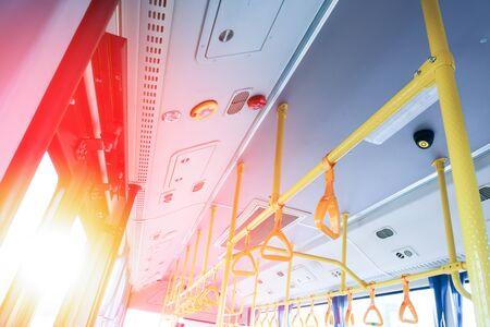 Passenger transport interior. Handles for passengers. Hanging handle holders in transport. Transport handrail. Safety equipment of the bus cabin. Hold on to the handrail to avoid falling passengers.handrail interior in the public transport of Thailand Stok Fotoğraf
