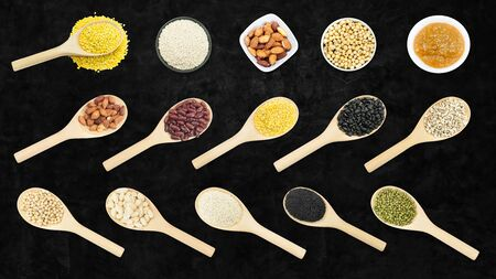 Collection set of beans and sesame on wooden spoons isolated on dark background,top view