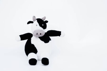 Doll cow Black and white Stuffed Dairy cow (Dairy cattle) isolated on white background