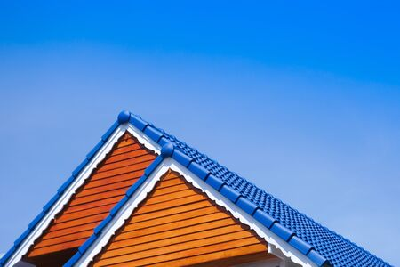 House blue roof on blue sky background,generic view to facade of a new modern building with blue sky,asia house style