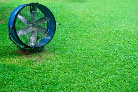 Large round powerful industrial professional metal iron fan with louvres at garden