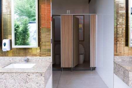 Interior of public clean toilet in a shared toilet there is a wide selection of sinks with mirrors Stock fotó