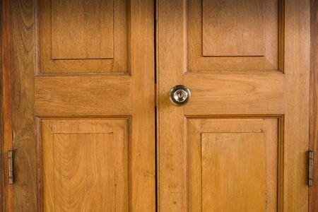 Lock on wood door,wood door entrance of residential house