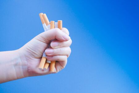 Broken cigarette on hand. Winning with addicted nicotine problems,No smoking. Quitting from addiction concept.