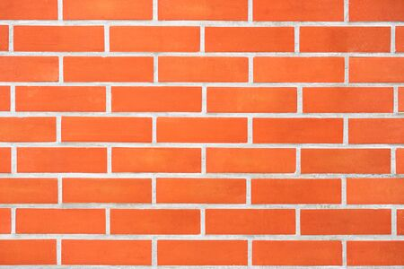 Saturated bright modern orange brick wall background for text and design