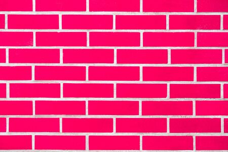Saturated bright modern pink brick wall background for text and design